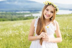 Cute child girl at camomile field Stock Photography