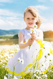 Cute child girl at camomile field Royalty Free Stock Photos
