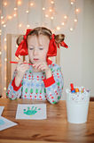 Cute child girl in Christmas sweater making handprints postcard Stock Images