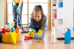 Cute child girl cleanses a floor in nursery at home Stock Photography