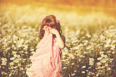 Cute child girl at field Stock Photos