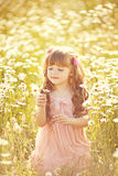 Cute child girl at field Royalty Free Stock Photos