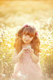 Cute child girl at field Stock Photography