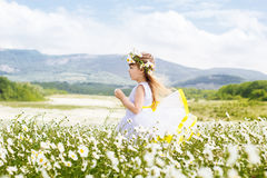 Cute child girl at field of camomiles flowers Stock Photo