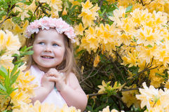 Cute child girl in flowers Stock Image