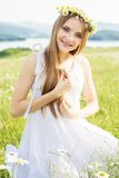 Cute child girl at green field Stock Photos