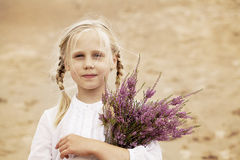 Cute Child Girl with Heather Flowers Royalty Free Stock Images