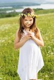 Cute child girl is holding daisy flower Stock Photography