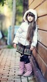 Cute child girl with long dark hair poses outdoors Royalty Free Stock Photos