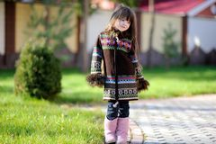 Cute child girl with long dark hair poses outdoors Stock Photos
