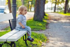 Cute child girl in park. Happy kid 2 years old.  royalty free stock image