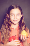 Cute Child Girl with pear fruit. Healthy Eating Royalty Free Stock Image