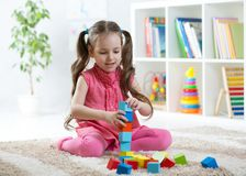 Child girl playing with block toys in daycare centre Royalty Free Stock Photography