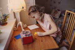 Cute child girl playing with mosaic at home in her room Royalty Free Stock Photo