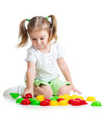 Cute child girl playing with  mosaic toy Stock Photos