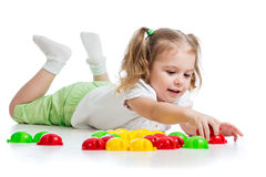 Cute child girl playing with mosaic toys Stock Photos