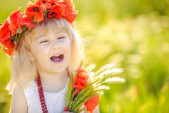 Cute child girl in poppy field Stock Photography