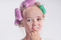 Cute child girl portrait in curlers Stock Images