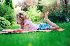Free Cute Child Girl Reading Book In Summer Garden Outdoor Royalty Free Stock Photo - 71711775