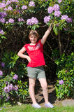 Cute child girl with rhododendron Royalty Free Stock Photos