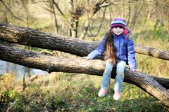 Free Cute Child Girl Sitting On A Tree Branch Stock Image - 21830841
