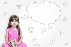 Closeup Cute little child girl in pink dress thinking with a thought bubbles royalty free stock photo