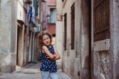 Cute child girl walking old city streets in Piran, Slovenia Stock Image