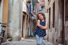 Cute child girl walking old city streets in Piran, Slovenia Royalty Free Stock Photos