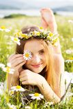 Cute child girl with wreath of chamomiles Stock Photography