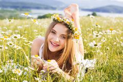 Cute child girl with wreath of chamomiles Stock Images