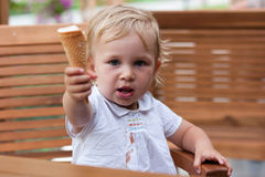 Cute child giving away her icecream Stock Photos