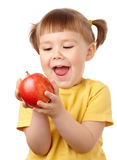 Cute child is going to bite an apple Stock Photography