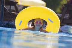 Cute Child Having Some Fun In Swimming Pool. Royalty Free Stock Photo