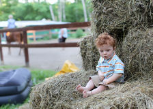 Cute child on hay in ranch Royalty Free Stock Images