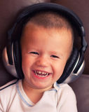 Cute child with headphone Royalty Free Stock Photo