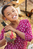 Cute Child with Hen Stock Image