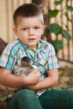 Cute Child Holding Duck Stock Photos