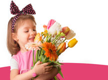 Cute child holding fresh spring flowers Stock Photo