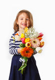 Cute child holding fresh spring flowers Stock Photography