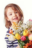 Cute child holding fresh spring flowers Royalty Free Stock Photo