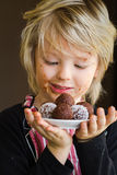 Cute child holding homemade chocolate treat Stock Photo