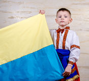 Cute child holding the national flag of Ukraine Stock Photos
