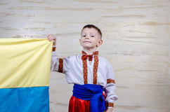 Cute child holding the national flag of Ukraine Royalty Free Stock Photo