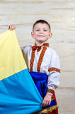 Cute child holding the national flag of Ukraine Royalty Free Stock Image