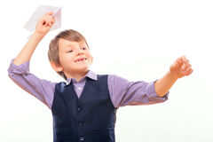 Cute child holding paper airplane Stock Photo