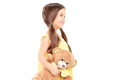 Cute child holding a teddy bear Stock Photo