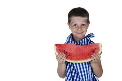 Cute child holding a watermelon slice. Portrait isolated on white of cute happy child holding a big watermelon slice looking in the camera with a cheerful look Royalty Free Stock Photo