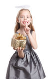 Cute child holding a wrapped Christmas present Royalty Free Stock Photo