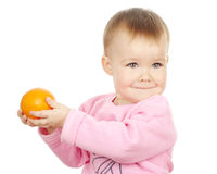 Cute child holds mandarin Royalty Free Stock Images