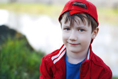 Free Cute Child In Red Cap At Outdoor Stock Photography - 31472172